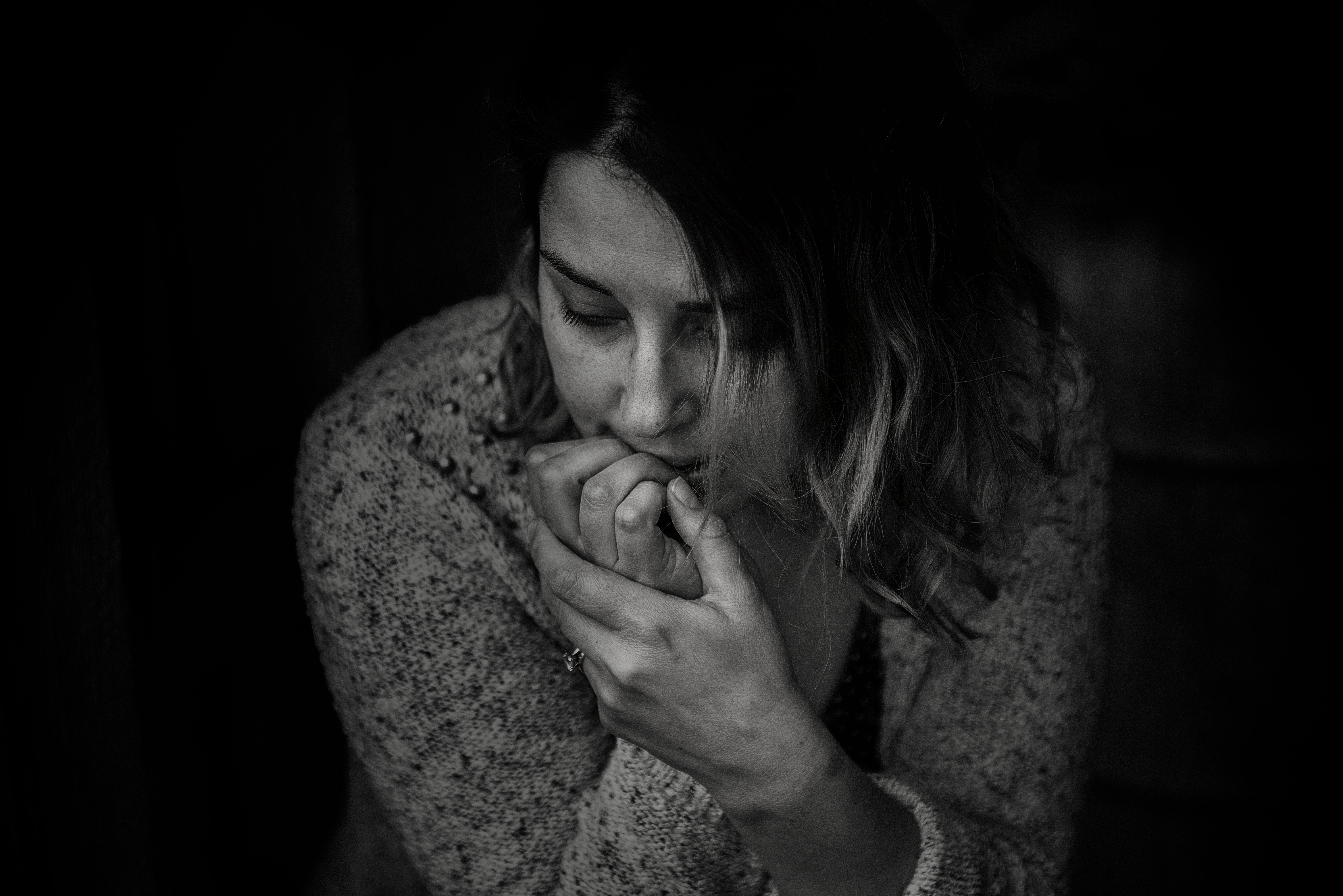 A woman with OCD biting nails