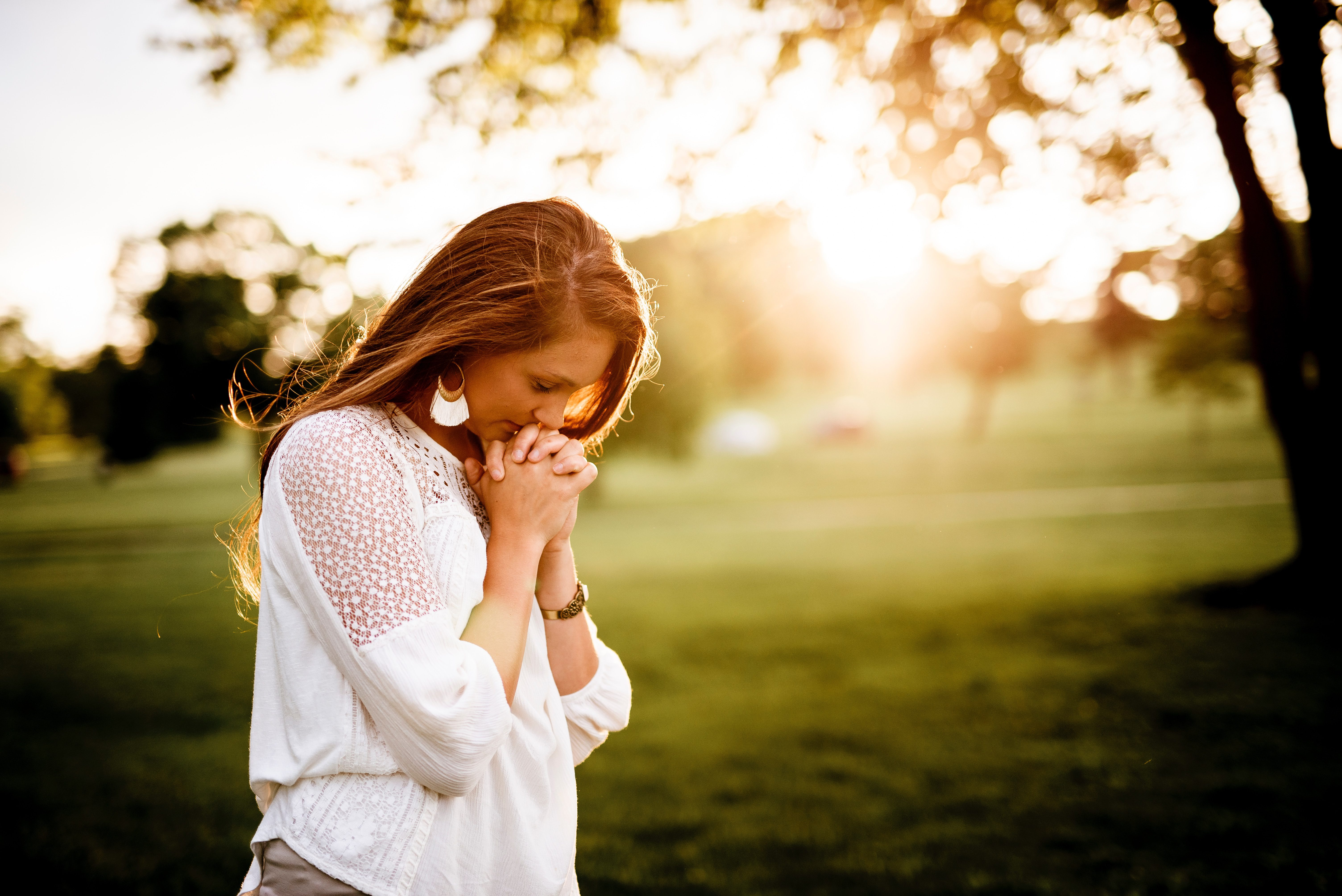 Stressed and anxious woman praying